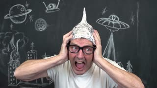 Man losing mind with tinfoil helmet