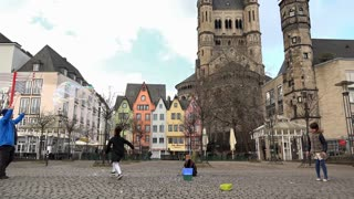 Man making bubbles in street of Cologne Germany 4k