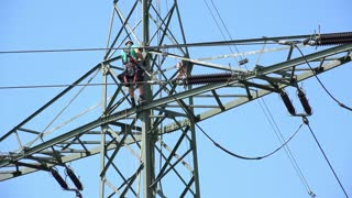 Man on power line securing harness 4k