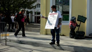 Man on Street Preaching Word of God