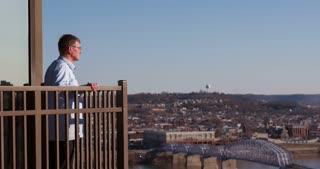 Man overlooking city down below 4k