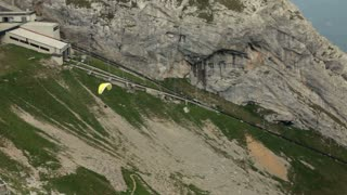 Man paraglides down Pilatus Mountain