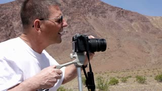 Man Photographing in the Mountains