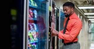 Man picking vending machine snack 4k.