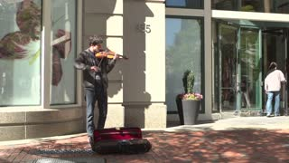 Man playing violin in streets of Boston