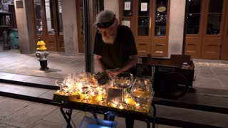 Man playing wine glasses as instrument in New Orleans 4k