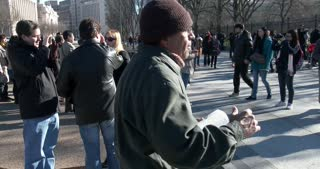 Man preaching from bible in front of White House with sound 4k