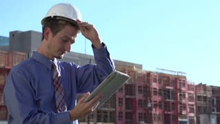 Man removes hard hat in hot heat