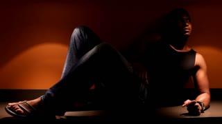 Man sitting on counter top Dramatic lighting