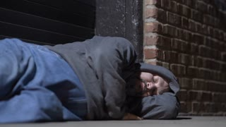 Man sleeping in cold city back streets at night 4k