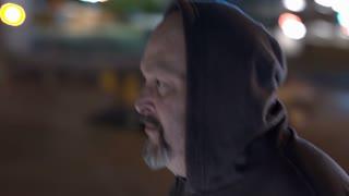 Man snooping around building looking into window 4k