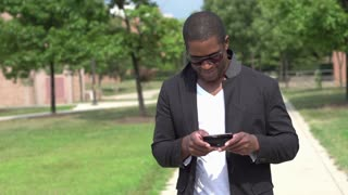 Man texting puts away cell phone