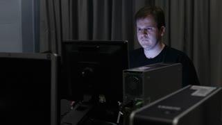 Man using computer lab in dark