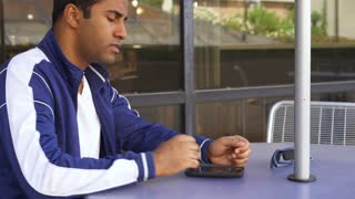 Man waiting looking at is cell phone frustrated 4k