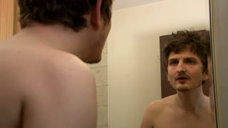 Man Waking Up Looking into Mirror