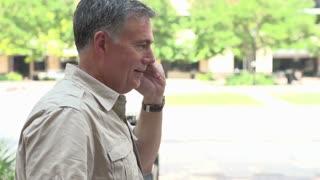 Man walking and talking on phone slow motion