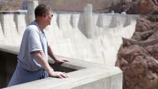 Man waving at Hoover Dam