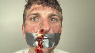Man with Duct tape on mouth Begging