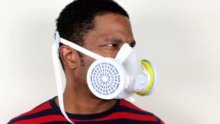 Man with Respirator on looking around