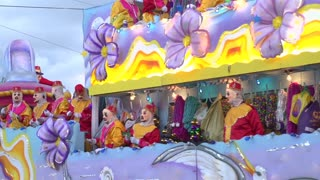 Mardi gras float in Endymion throwing beads to crowd 2014