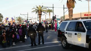 Mardi Gras Men on Stilts Walking