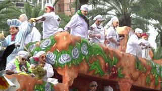 Mardi Gras parade float throwing beads slow motion