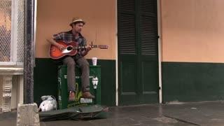 Mardi Gras Street performer playing guitar