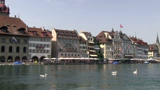 Market street along water in Lucerne
