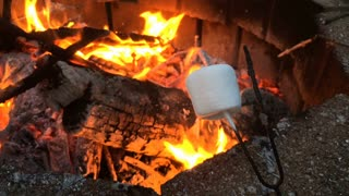 Marshmallow cooking at camp fire