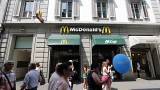 McDonalds with people walking by in Luzern
