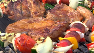 Meat cooking on fire pit grill close up 4k