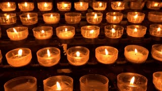 Memory candles burning at church 4k