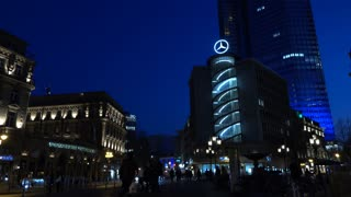 Mercedes Benz building in downtown Frankfurt Germany at night 4k
