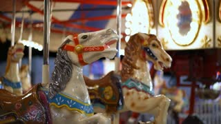 Merry go round horses at carnival ride during evening 4k