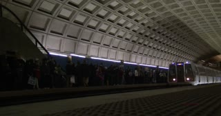 Metro train enters station in Washington DC 4k