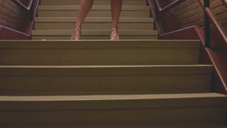 Model standing in stairwell