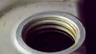 Motor oil put into car engine slow motion