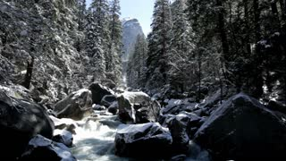 Mountain in background of snow covered river