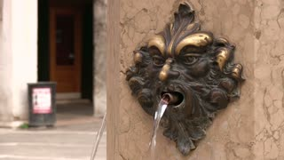 Mouth fountain with pouring water