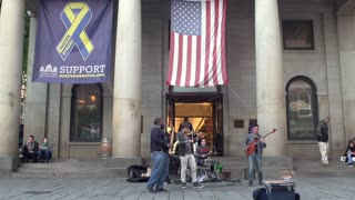 Music group performs for Quincy Market customers in Boston