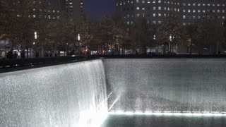 National September 11 Memorial Fountains in New York City at night 4k