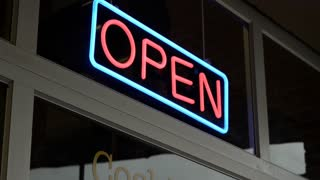 Neon open sign in store front window 4k