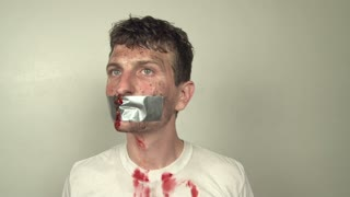 Nervous man with Duct Tape on Mouth