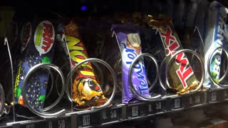 Nestle Lion candy bar coming out of German vending machine 4k