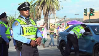 New Orleans Officer standing on street of Endymion parade