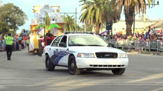 New Orleans Police car driving through Endymion