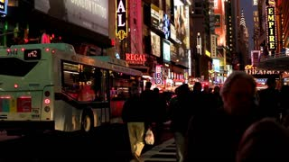 New York City at night with pedestrians