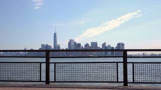 New York City in background with focus on fence along water edge 4k