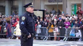 New York City Police Officer standing along parade route 4k