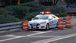 New York City police vehicle on side of highway 4k